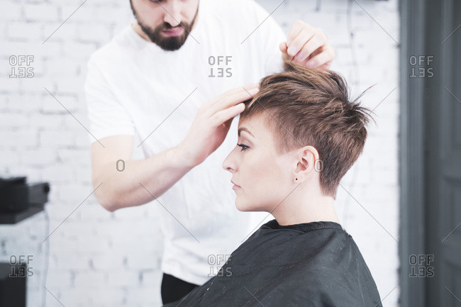Hairdresser combing the woman's fingers