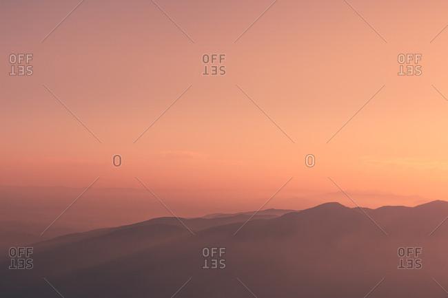 Sunset sky over mountain ridge