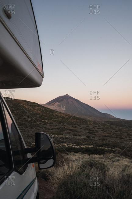 Camper car against remote mountain