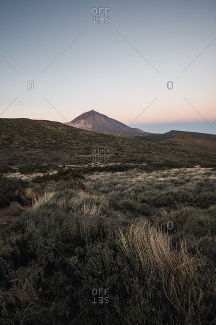 Picturesque view of remote mountain top in desert valley with calm morning light