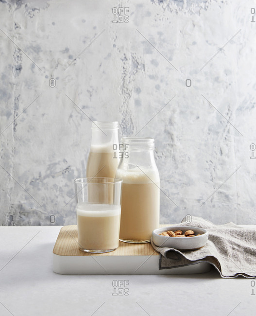 Glasses of almond milk on a wooden tray