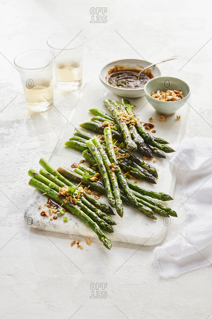 Grilled asparagus skewers drizzled with sauce