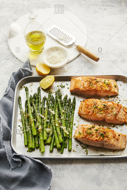 Tray of baked asparagus and salmon