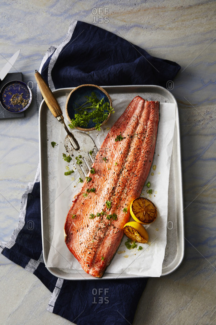 Baked salmon garnished with parsley