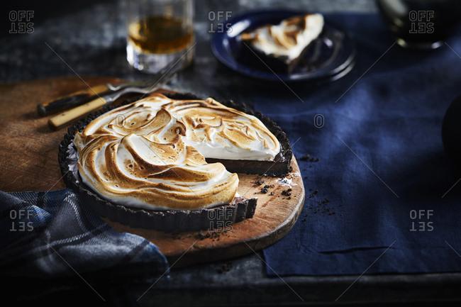 Chocolate whiskey tart with toasted meringue
