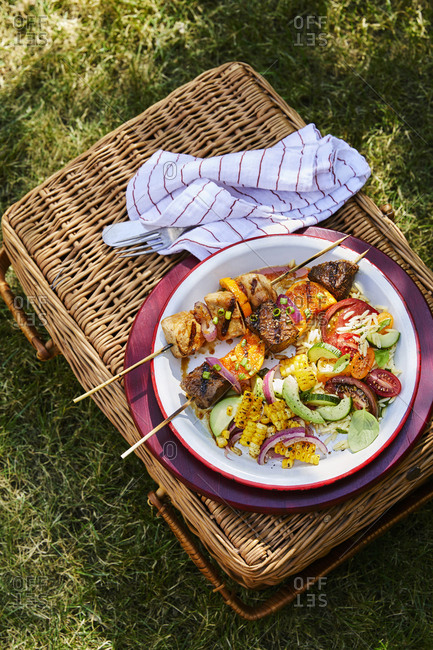 Kebabs on dish outdoors - Offset