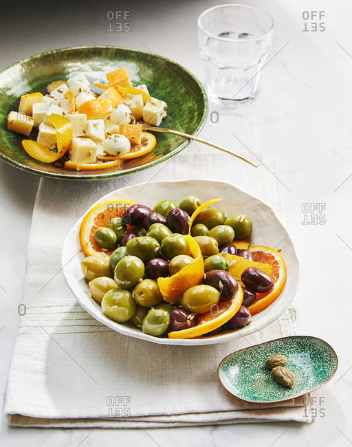 Sicilian olives and bocconcini with orange slices
