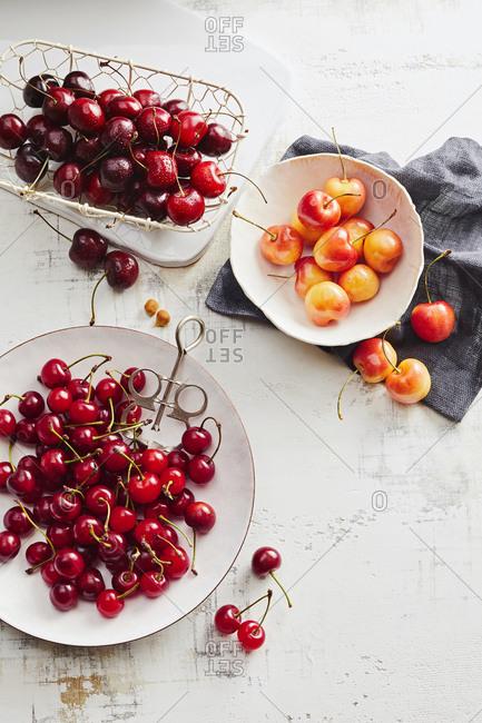 Overhead view of three varieties of cherries