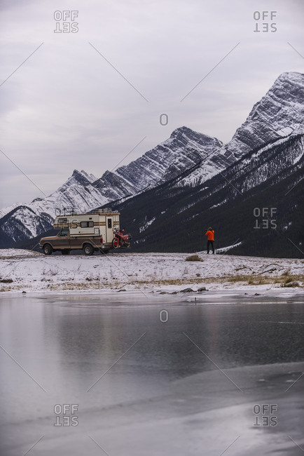 Man taking photo of Camper Truck with Touring Motorcycle in Canmore