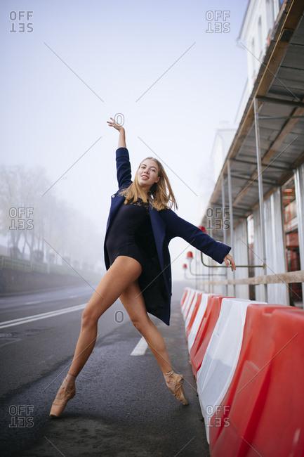 Woman ballerina on the road