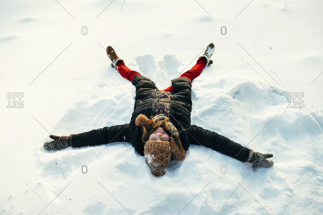 Woman lying in the snow