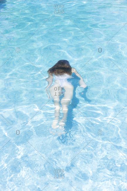 Young woman in white bikini underwater