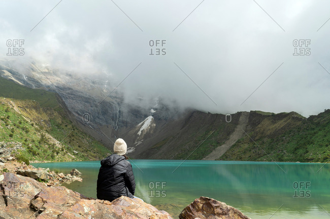 Green Lake. Young Hip Woman Exploring The Andes Mountains.