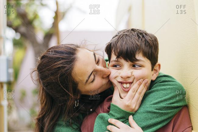 Girl kissing a boy outdoors