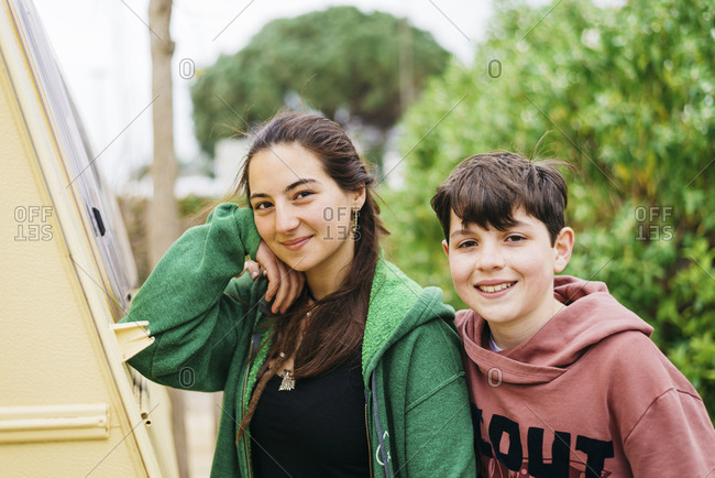Portrait of smiling couple standing outdoors while looking camera