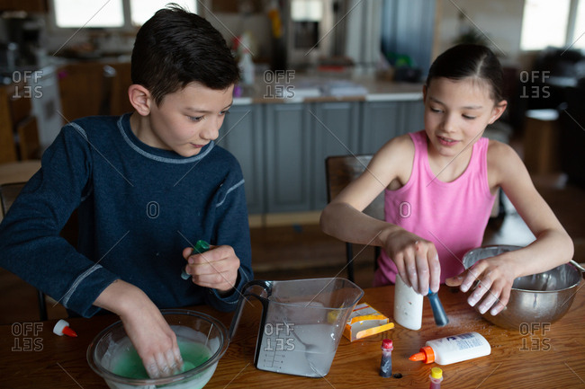 Kids making homemade slime together at home