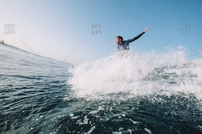 Canary Islands - May 15, 2019: A surfer takes off on a wave