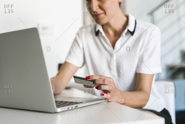 Woman using a credit card for online shopping