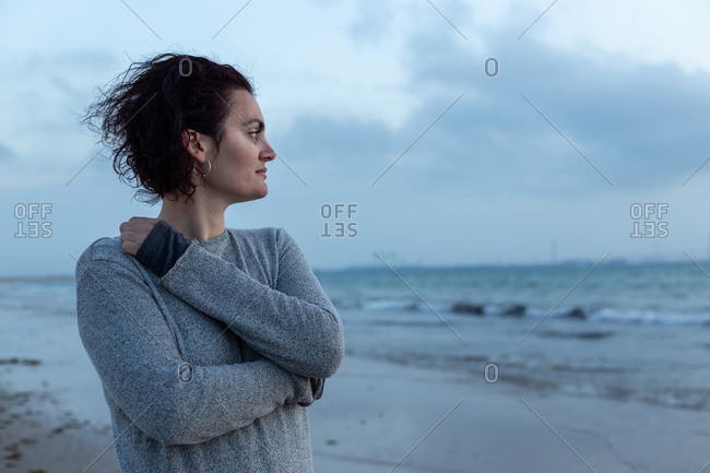 Portrait of a beautiful woman on the beach looking at the sea