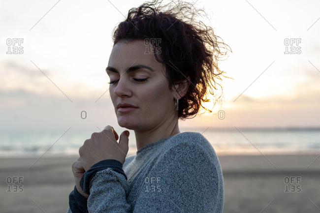 Portrait of a woman feeling the wind on the beach