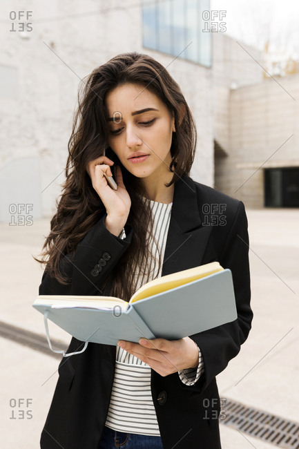 Concern young attractive woman talking by the phone