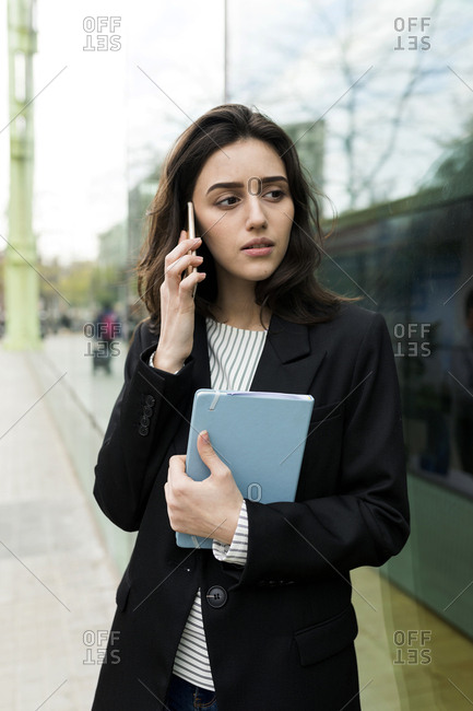 Attractive  young  business woman using smart phone in the city