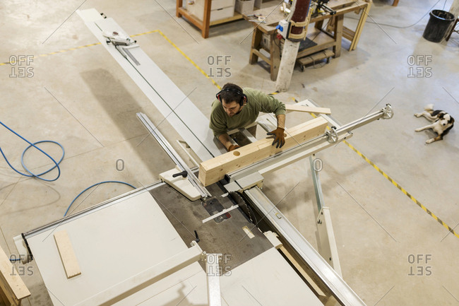 Overhead view of male carpenter working in workshop