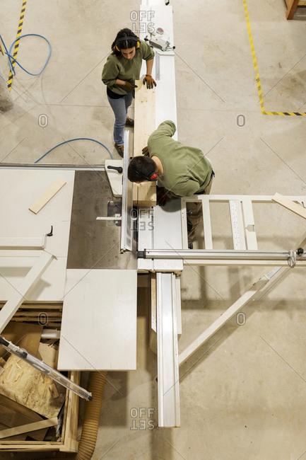 Overhead view of carpenterr working in workshop