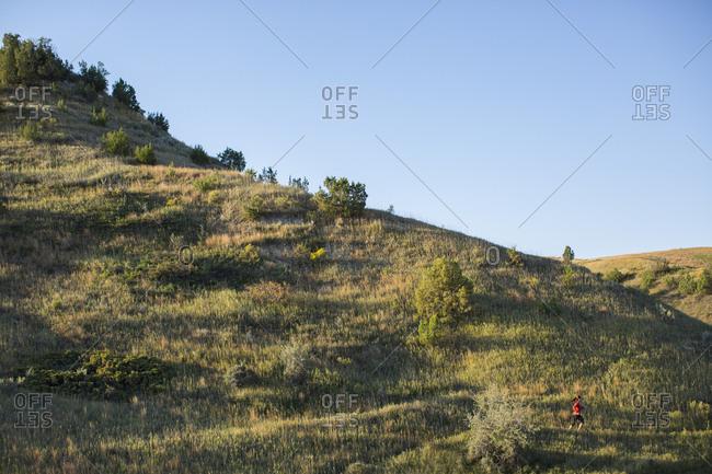 Woman trail running in Theodore Roosevelt National Park, North Dakota