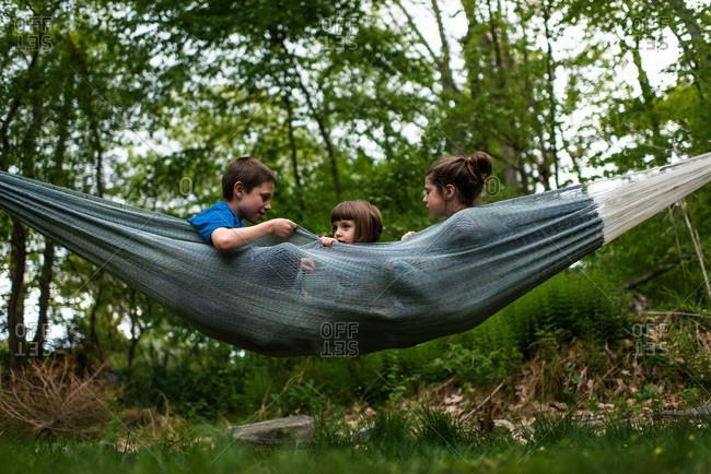 Siblings swinging in a hammock