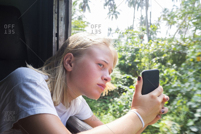 Girl taking picture through train window