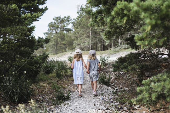 Girls walking holding hands
