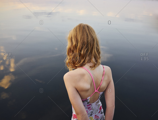 Girl standing at sea - Offset
