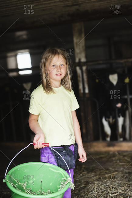 Girl in cowshed