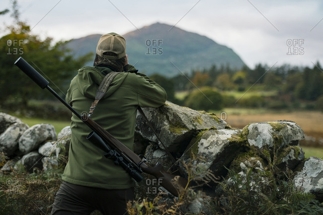 Hunter in mountains