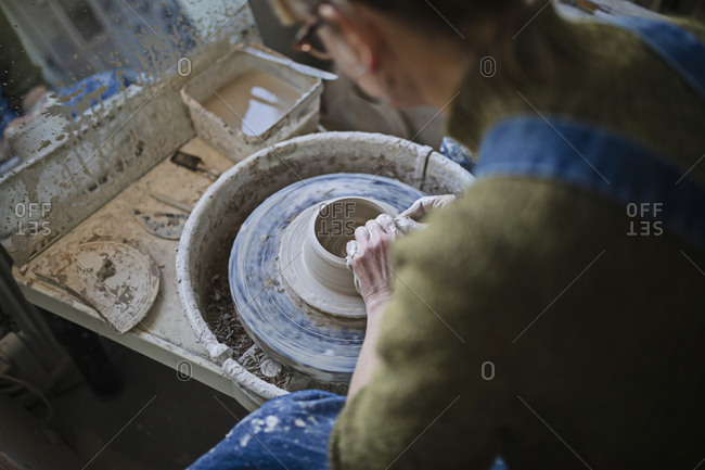 Potter using potters wheel - Offset