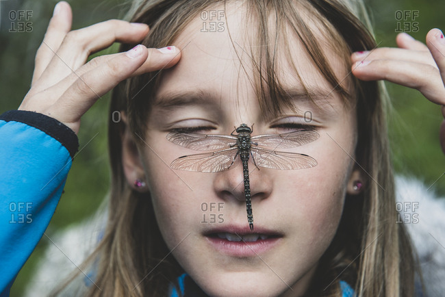 Dragonfly on girls face