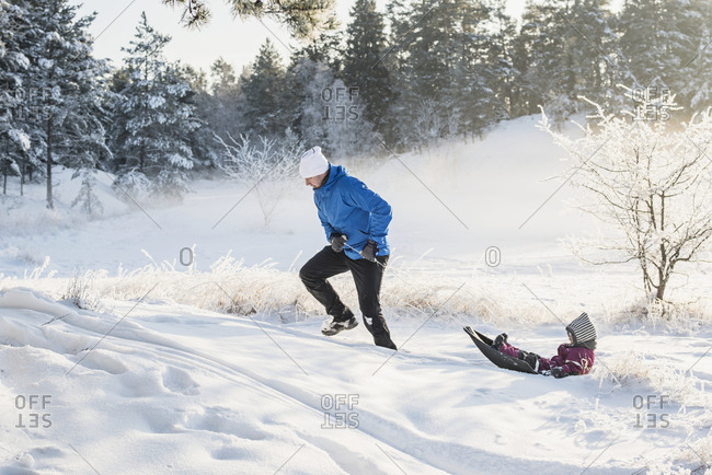 Father with daughter sledging