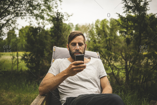 Man using phone in garden