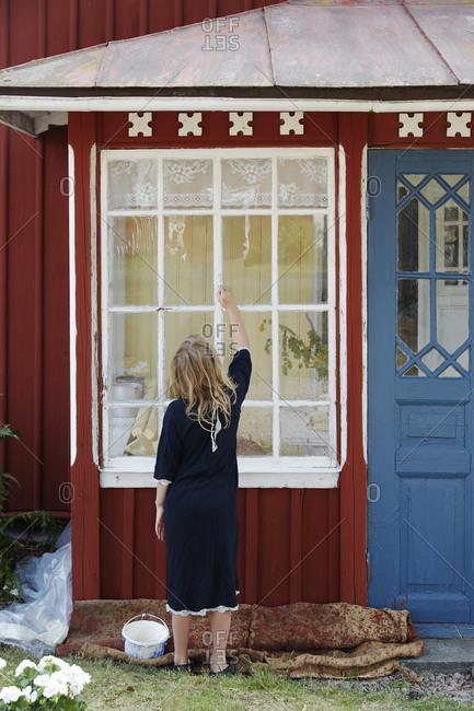 Girl painting windows