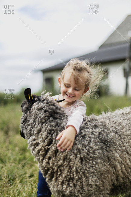 Girl stroking sheep