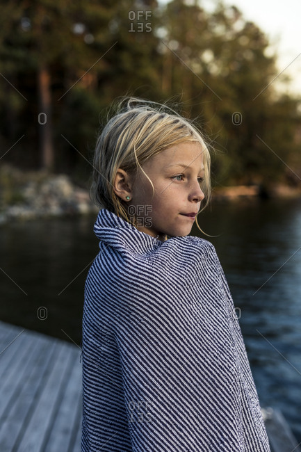 Girl wrapped in towel looking away