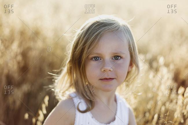 Girl on oat field
