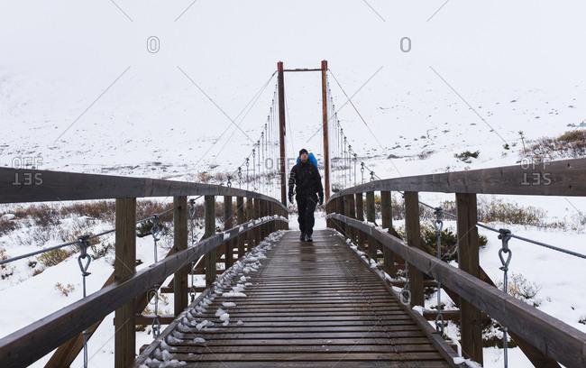 Hiker on wooden bridge