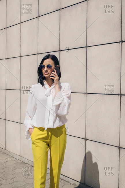 Young businesswoman talking on cell phone outdoors