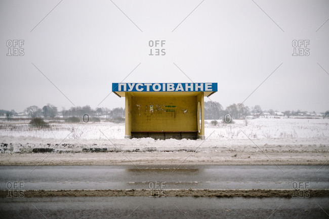 Ukraine - May 17, 2019: Bus stop shelter on snowy streetside