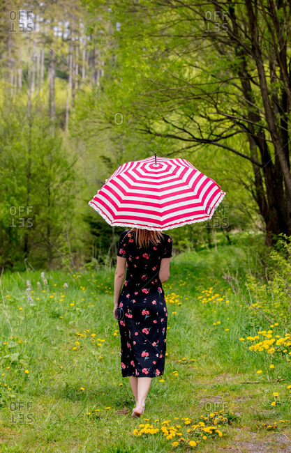 Young woman with umbrella at outdoor