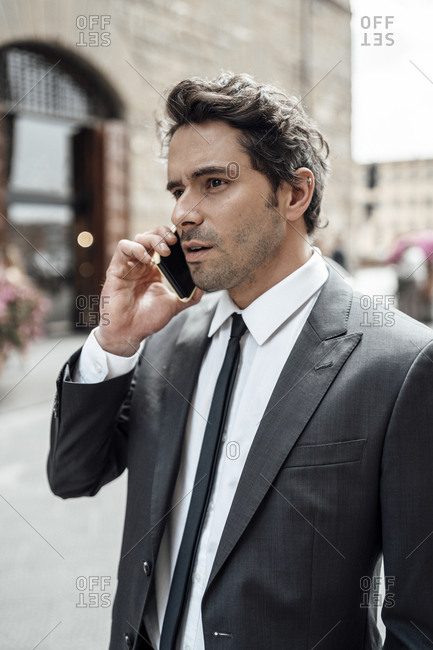 Businessman in the city during a business call