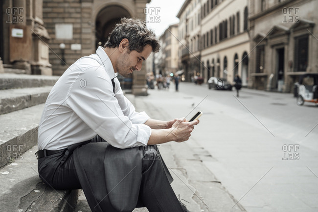 Businessman in the city using the smartphone