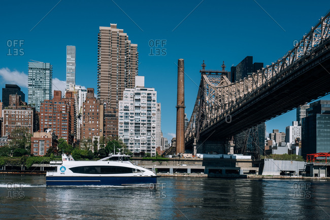 New York City - USA - May 15 2019: Queensboro bridge and midtown apartment buildings on east riverside view from Roosevelt Island